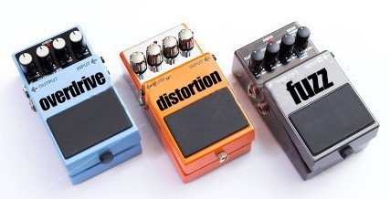 stock-photo-guitar-pedals-set-of-guitar-effect-pedals-on-white-background-679817233.jpg