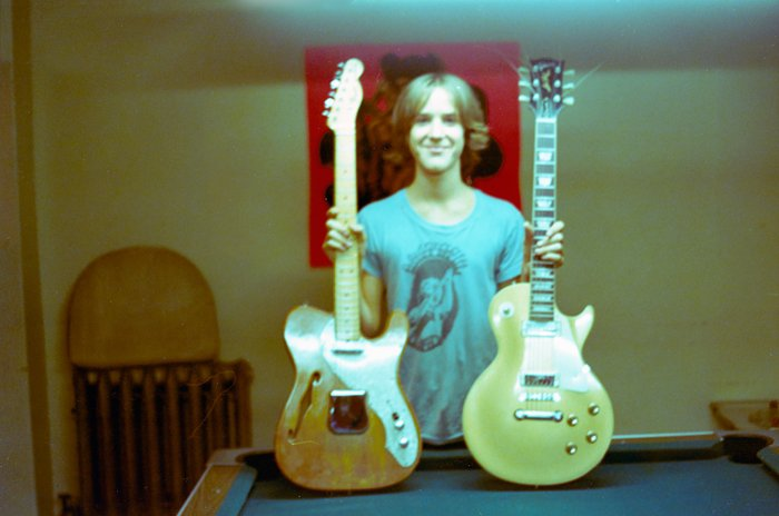 vintage guitars and person.jpg