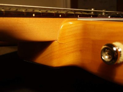 crack in guitar neck pocket