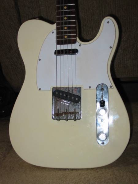 Brown Shoe Polish White Guitar Body